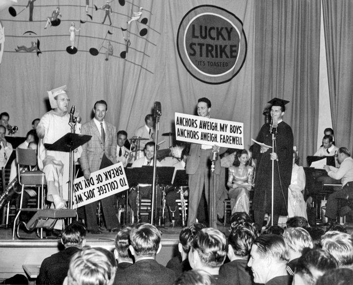 Kay Kyser (in cap and gown) and his band entertain U.S. Navy personnel during a live NBC radio broadcast of Kay Kyser's Kollege of Musical Knowledge, ca. 1943. North Carolina Collection, University of North Carolina at Chapel Hill Library.