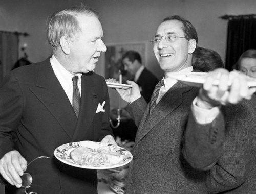 Comedy icons, W.C. Fields & Groucho Marx, meet up at the buffet table at a party.