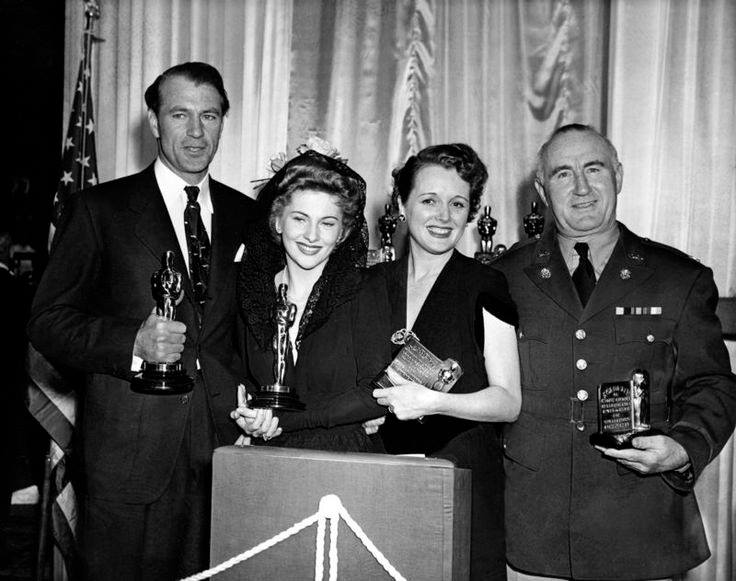 Best Actor Gary Cooper, Best Actress Joan Fontaine, Best Supporting Actress Mary Astor and Best Supporting Actor Donald Crisp at the Academy Awards Ceremony on February 27, 1942.