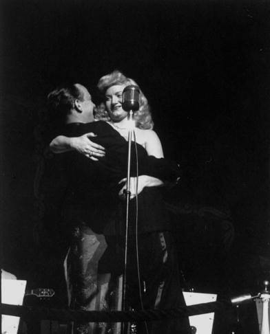 Dagmar dips John Daly during an act at Constitution Hall. January 1, 1951