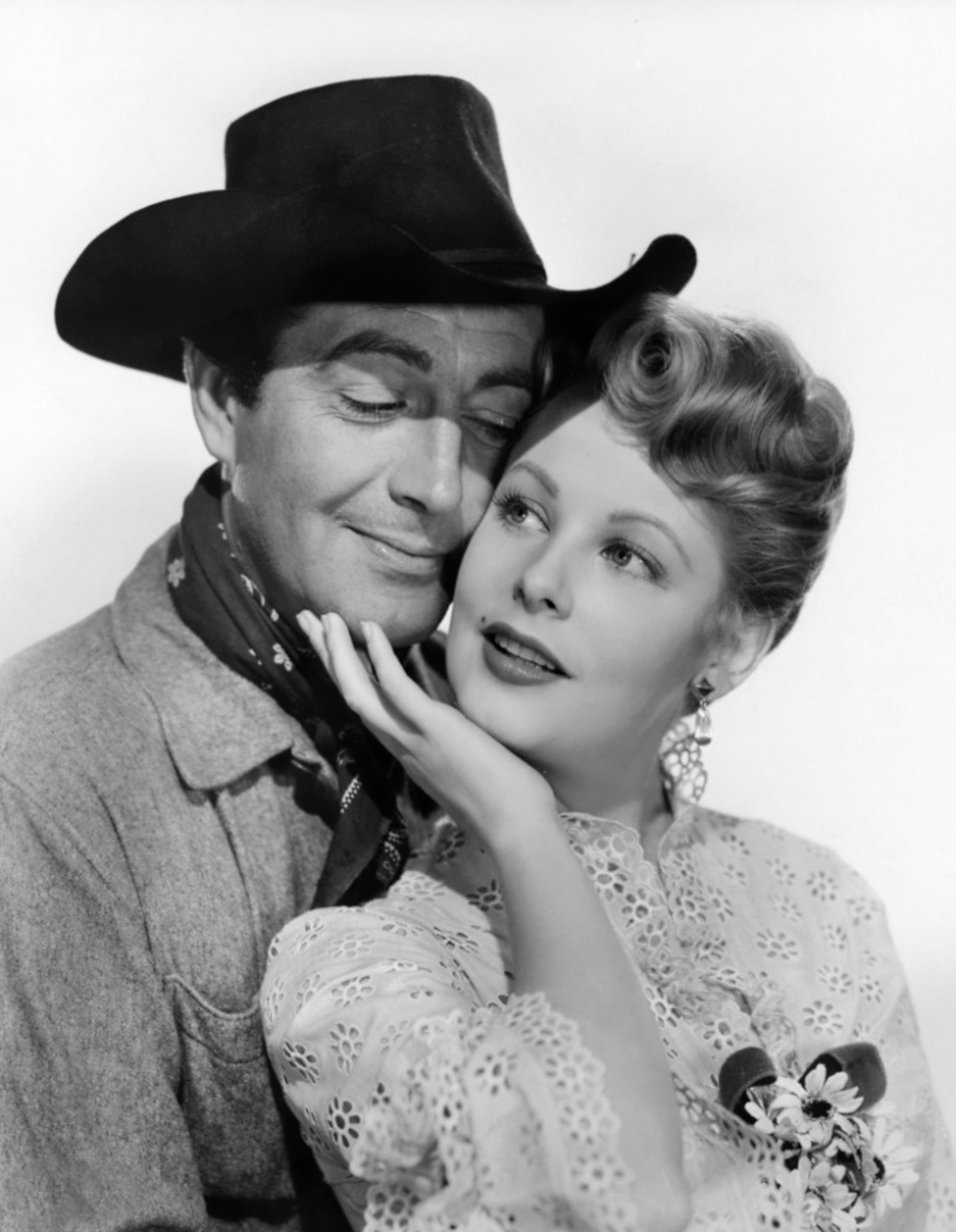 Arlene Dahl with  Robert Taylor