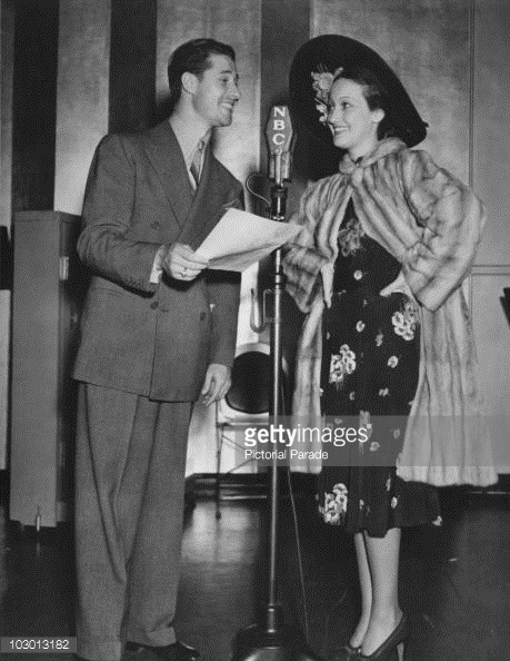 actress Dorothy Lamour and Actor Don Ameche  with an NBC microphone in.