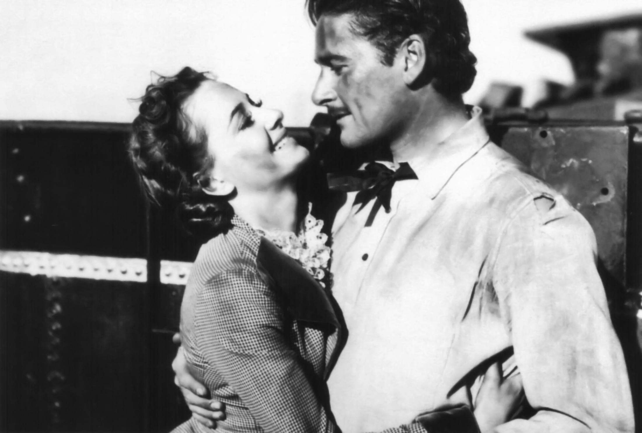 Olivia de Havilland with Errol Flynn