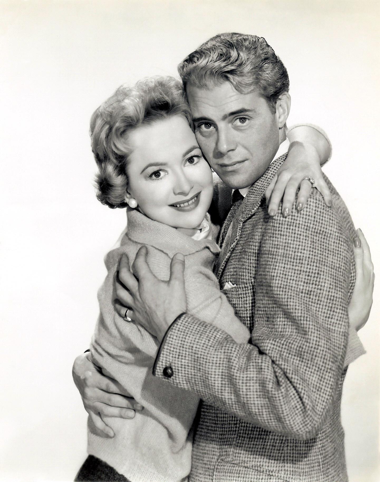 Olivia de Havilland with Dirk Bograde