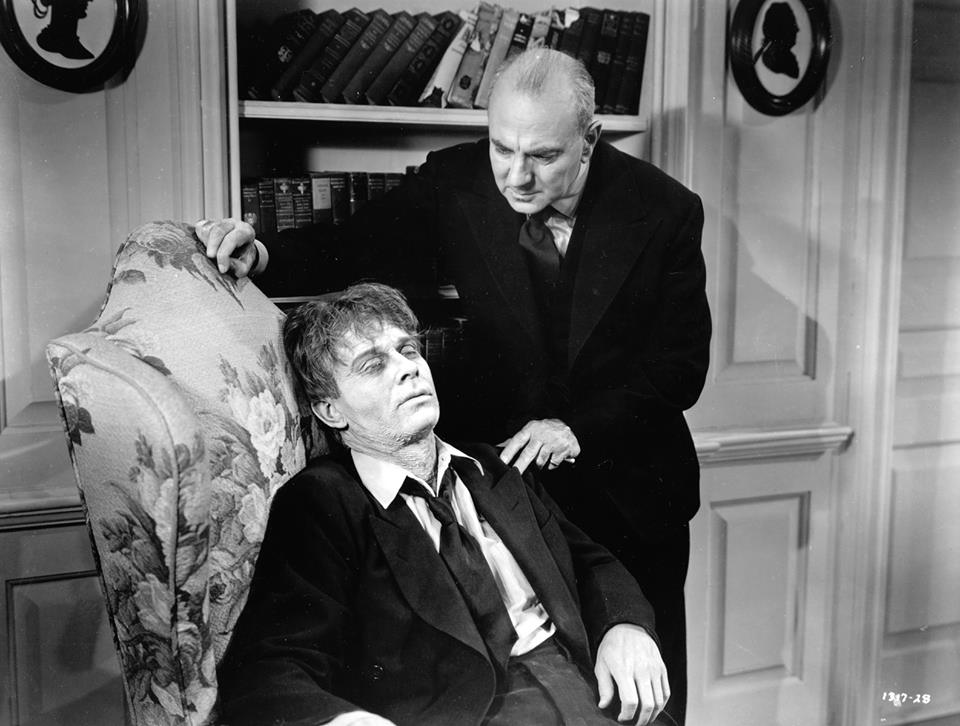 "star George Zucco (right), with David Bruce in Universal's 1943 shocker, ""The Mad Ghoul."""