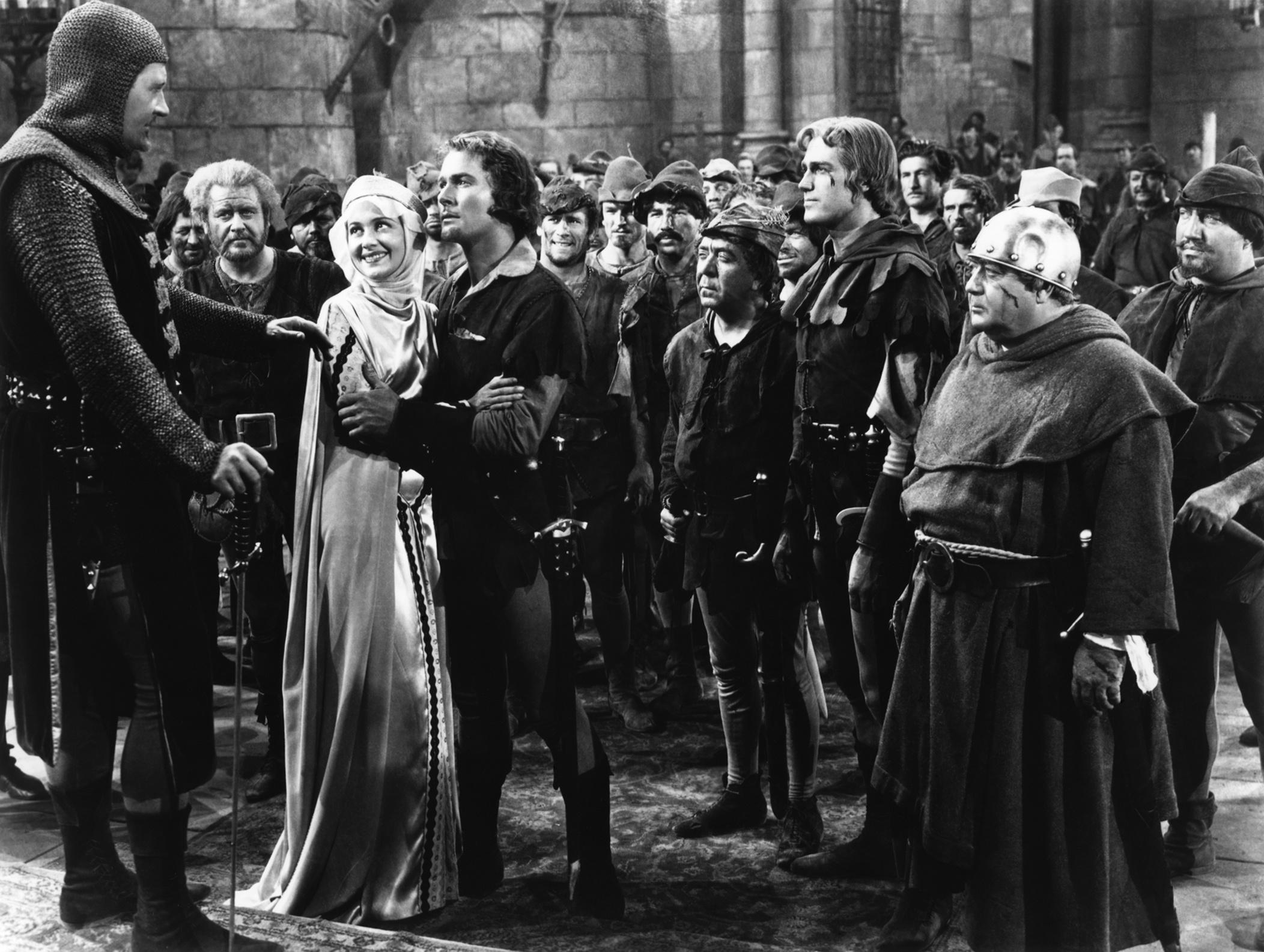 Ian Hunter, Alan Hale Sr., Olivia de Havilland, Errol Flynn, Herbert Mundin, Patric Knowles, Eugene Pallette