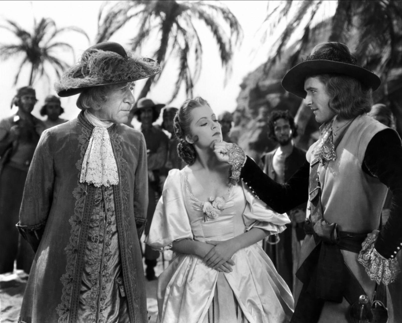 Errol Flynn With Henry Stephenson and Olivia de Havilland