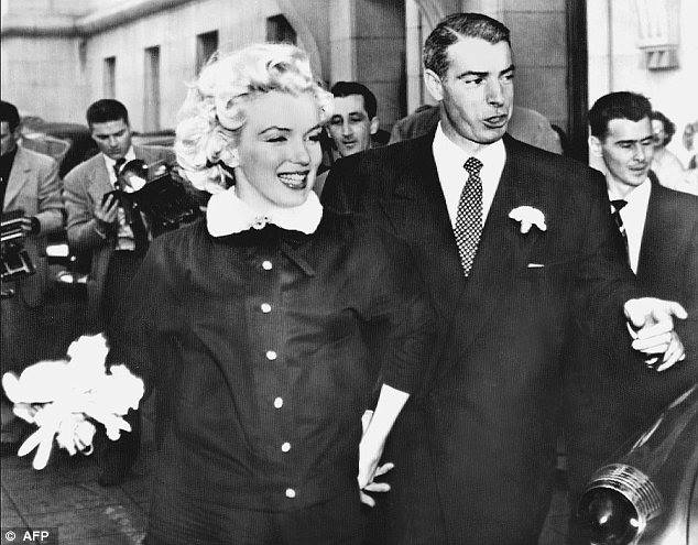 Joe DiMaggio and Marilyn Monroe (husband,wife)