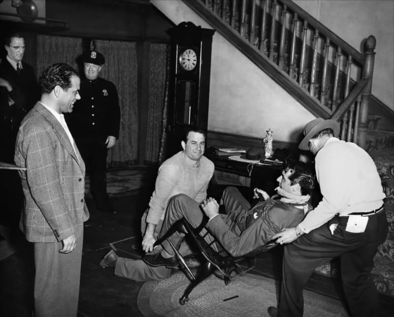 Director Frank Capra (far left)