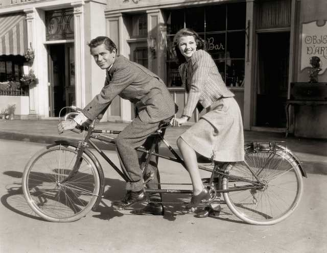 Glenn Ford and Rita Hayworth take time out for a bike ride during the making of