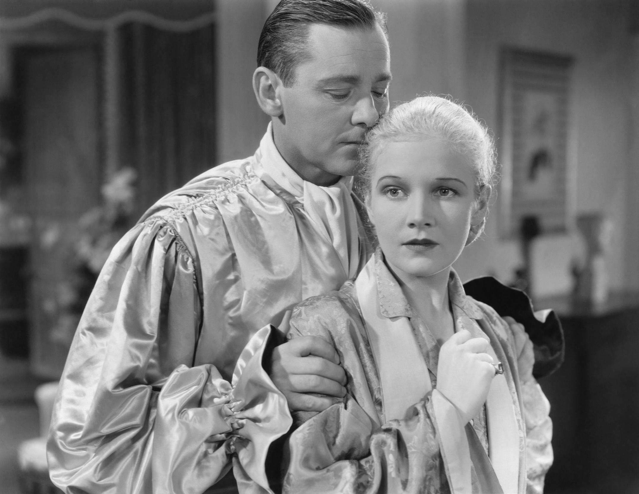 Ann Harding with Herbert Marshall.
