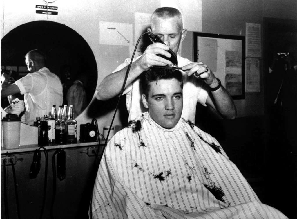 Photo of Presley getting his Army haircut