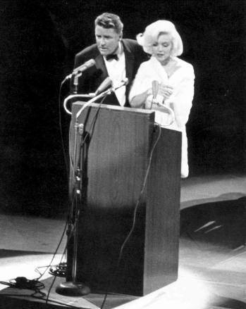 Peter Lawford with Marilyn Monroe at John F. Kennedy's birthday celebration in 1962.