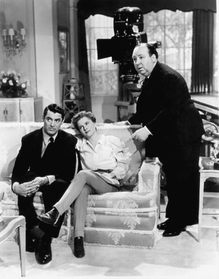 Joan Fontaine with Cary Grant and Alfred Hitchcock