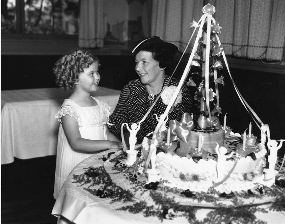 Photo of Temple at her birthday party in 1936 with her mother