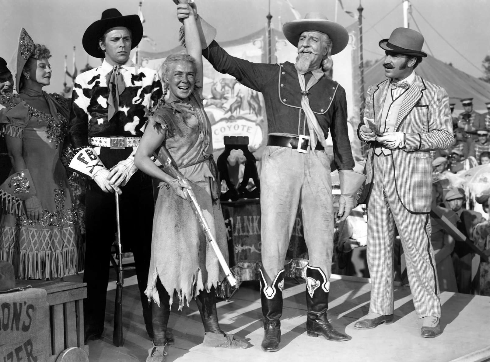 Betty Hutton in Annie Get Your Gun  (L to R) Howard  Keel, Betty Hutton, Louis Calhern, Keenan Wynn