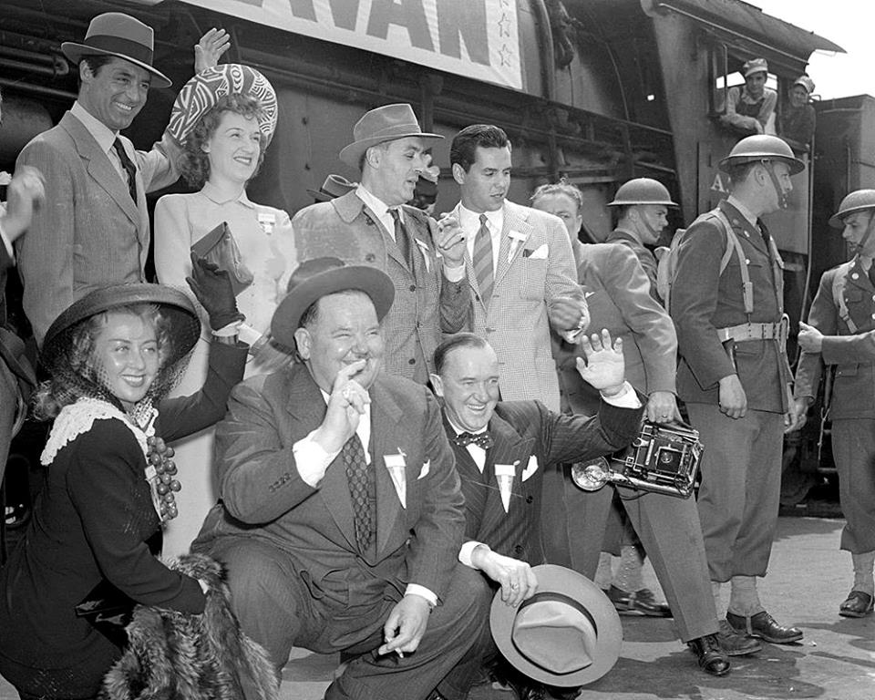 Joan Blondell, Oliver Hardy, Stan Laurel, Cary Grant, Rise Stevens, Charles Boyer and Desi Arnaz, were among the troupe of the Hollywood Victory Caravan which left Los Angeles, California, by train to tour the nation's largest cities to give benefit performances for the Army Emergency and Navy Relief Societies. April 27, 1942