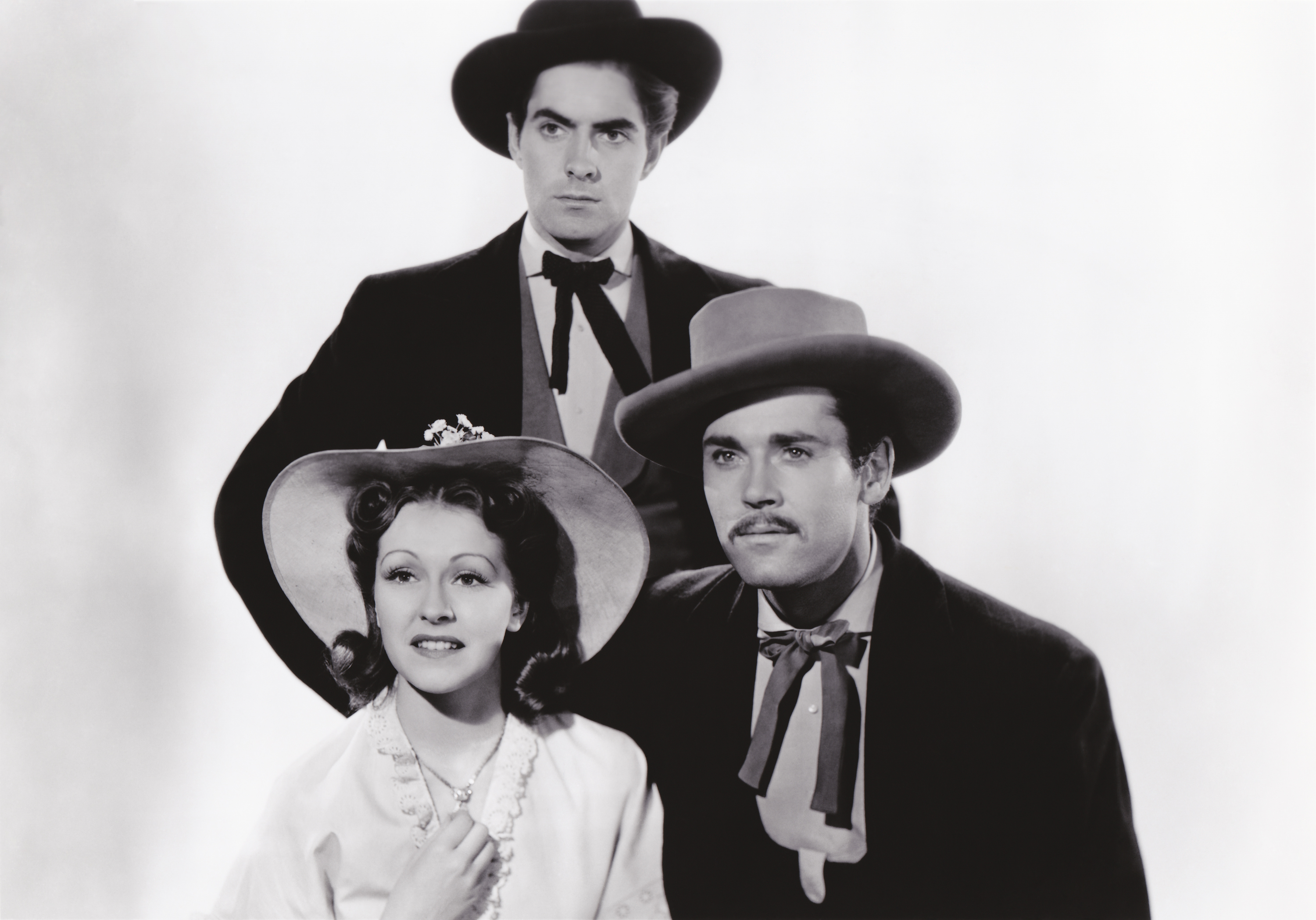 Nancy Kelly in Jesse James with (L to R) Nancy Kelly, Tyrone Power, Jr., Henry Fonda (Courtesy of Sarah and Michelle)