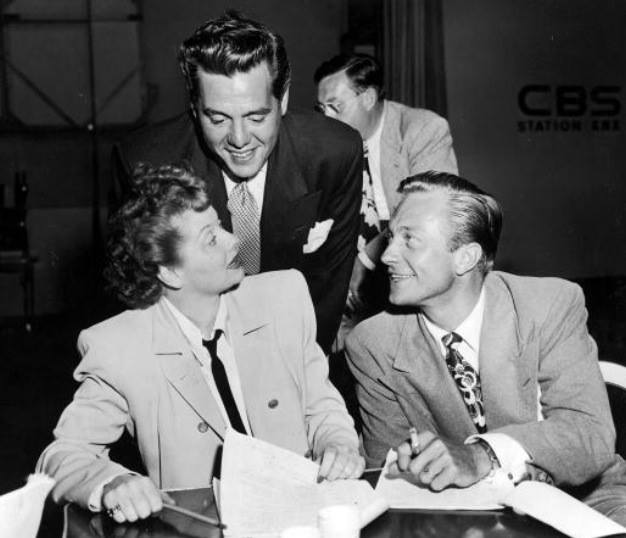 Desi Arnaz visits his wife Lucy on the set of her radio series, MY FAVORITE HUSBAND, co-starring Richard Denning, right.