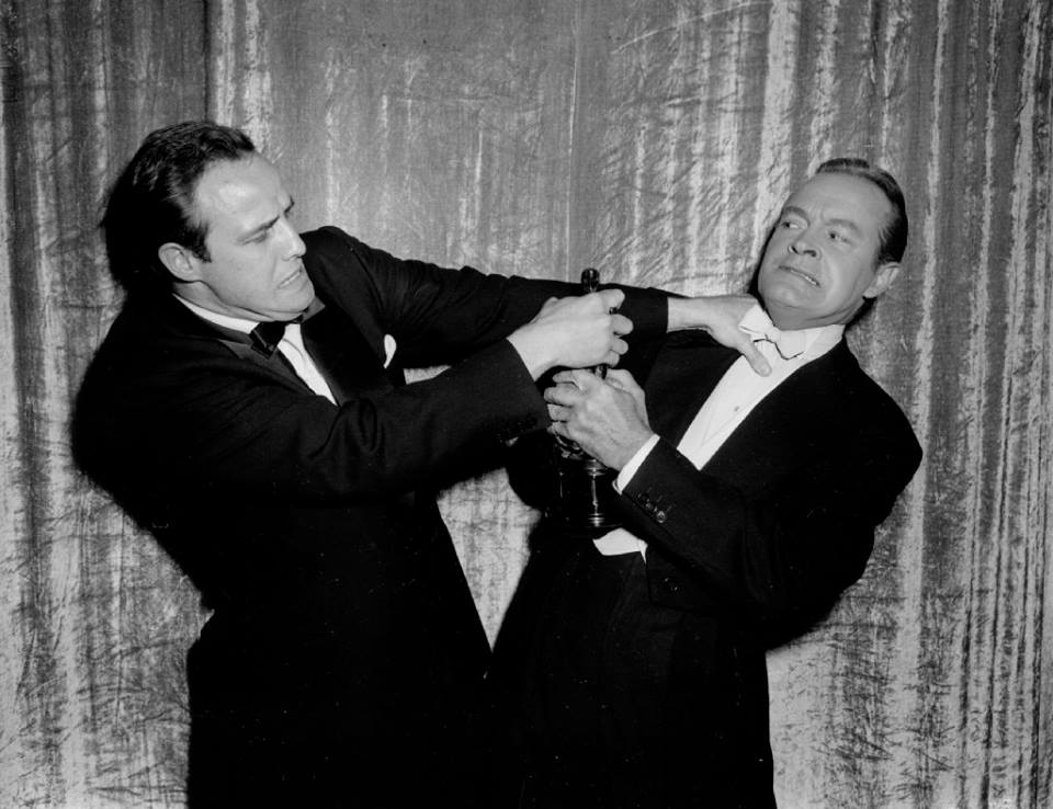 Photo of Brando fighting with Bob Hope for his Oscar for