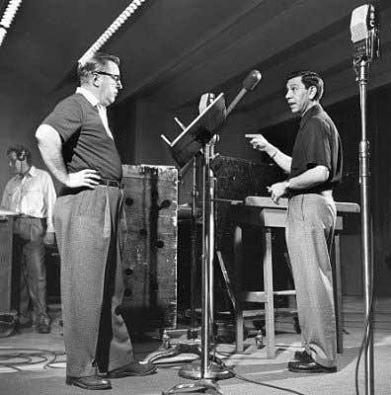 Ben Alexander (Frank Smith) and Jack Webb (Sgt Joe Friday) confer in the Radio studio for Dragnet, ca. 1953