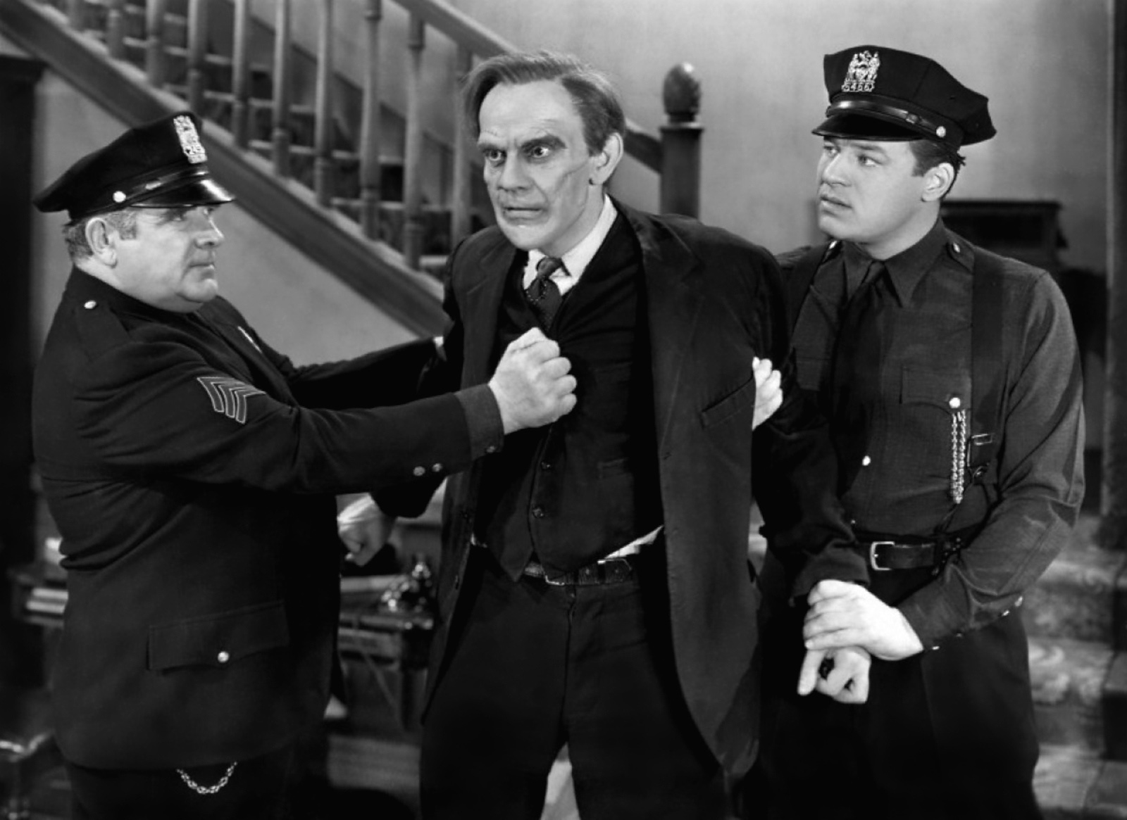 Raymond Massey with Jack Carson and  John Ridgely.