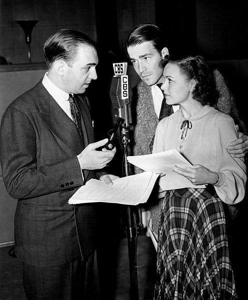 Photo of Santos Ortega as Inspector Queen (father of Ellery), Hugh Marlowe as Ellery Queen and Marian Shockley as Ellery's assistant, Nikki, from the radio program The Adventures of Ellery Queen.
