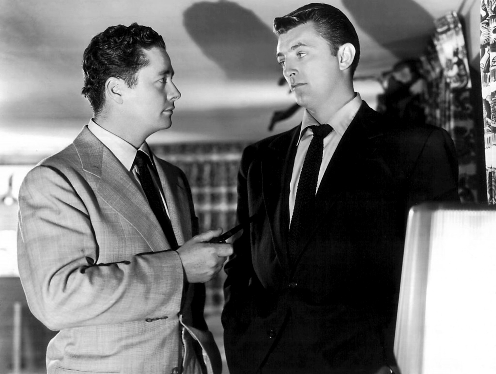Robert Mitchum with With Tim Holt (L)