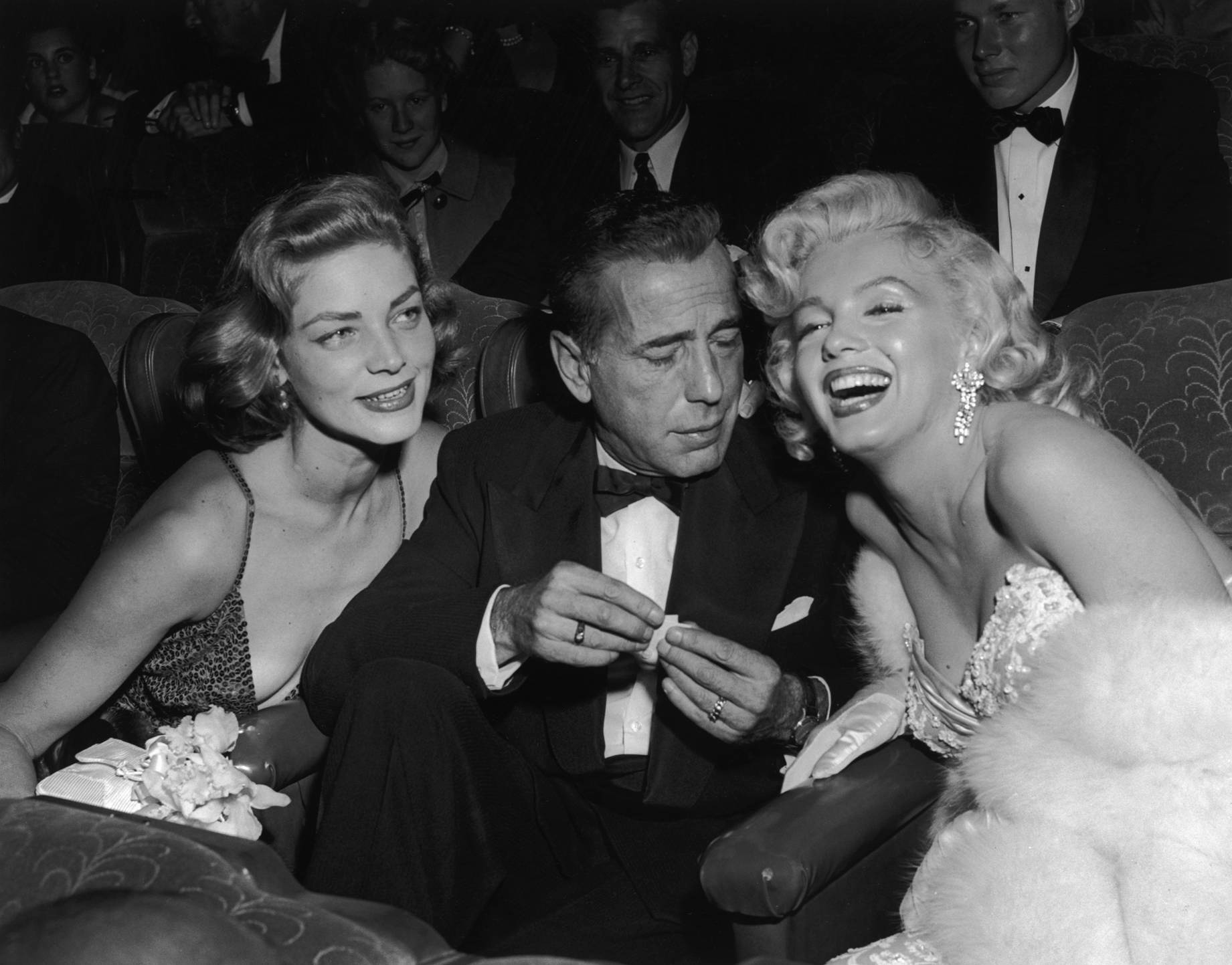 (L to R) Lauren Bacall, Humphrey Bogart, Marilyn Monroe