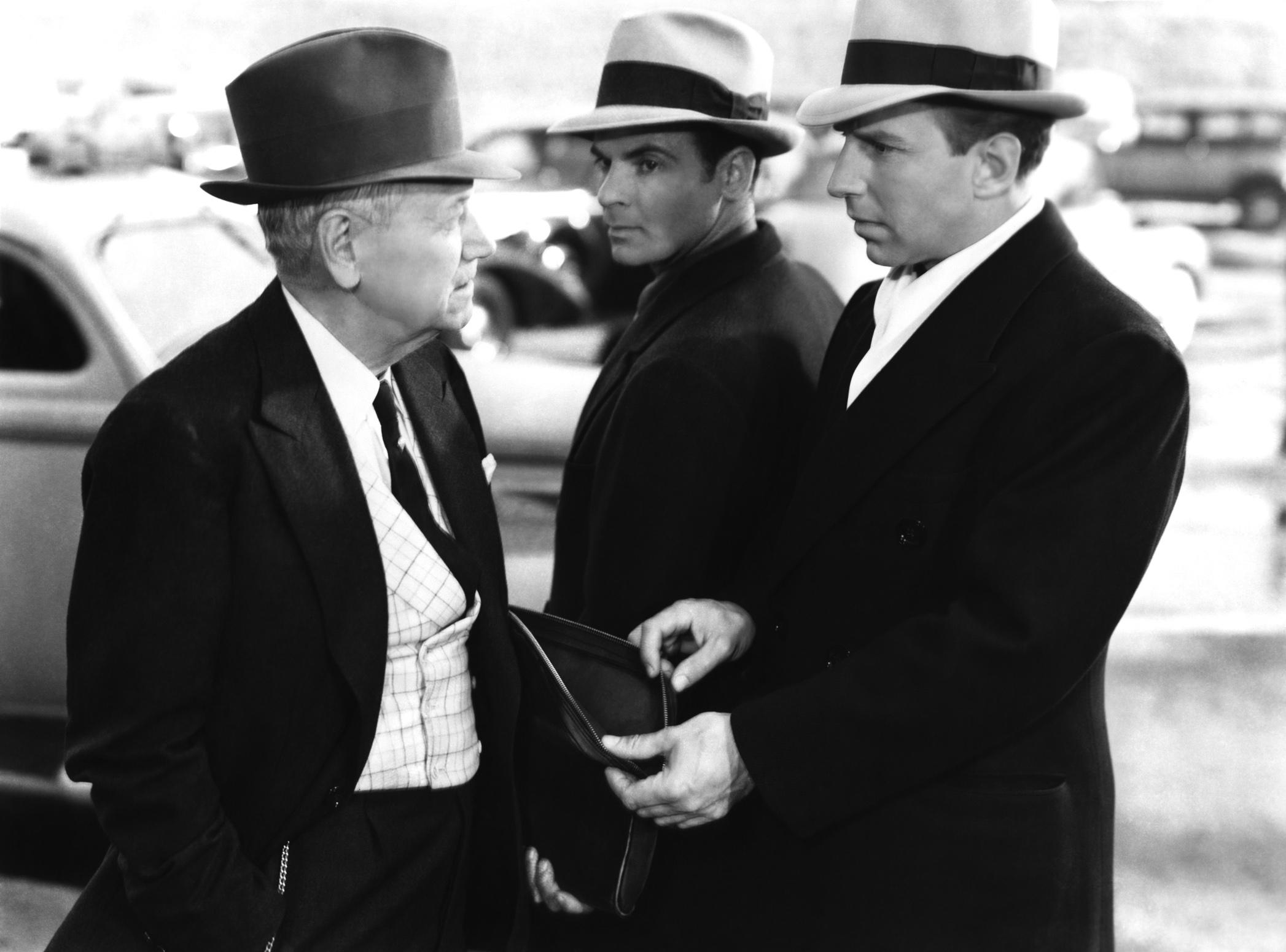 Lloyd Nolan in Johnny Apollo (L to R) Charley Grapewin, Marc Lawrence, Lloyd Nolan