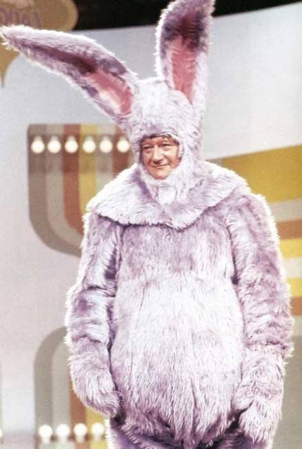 JOHN WAYNE wearing his Easter bunny well on an episode of the classic TV comedy, Laugh-IN.