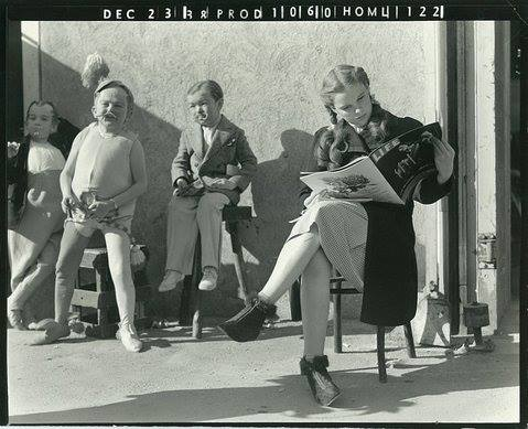 Judy Garland reading LIFE magazine on the set of