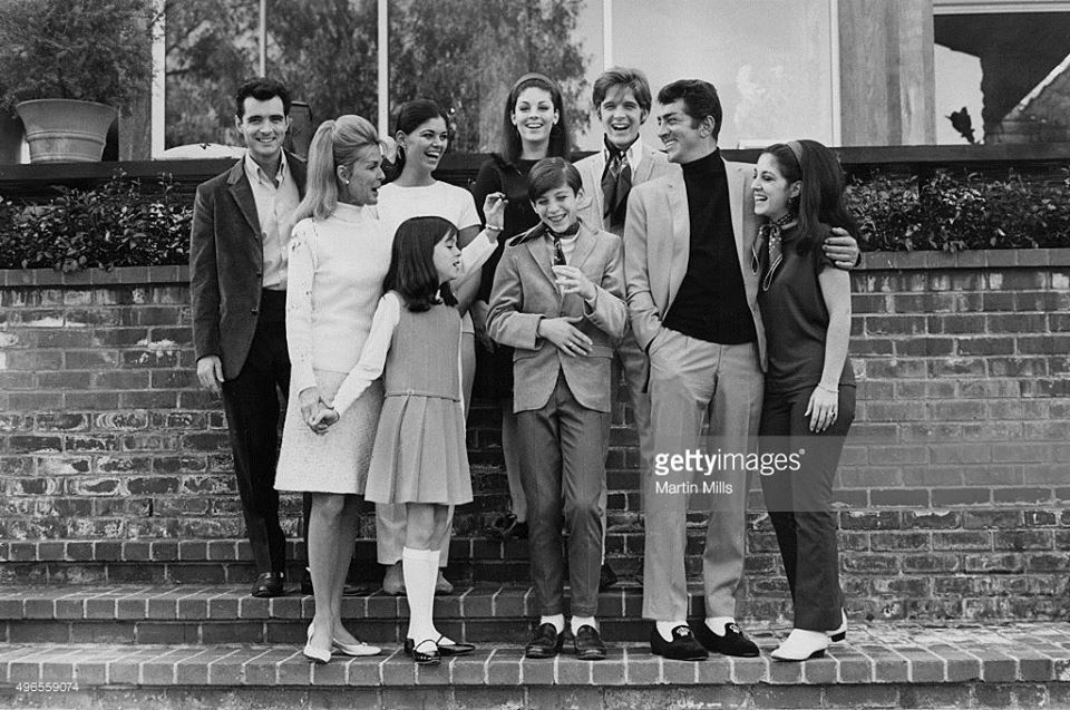 Dean Martin with his wife Jeanne and children (Gail, Craig, Claudia, Deana, Gina, Ricci and Dean Paul) pose for a family portrait in 1966 in Los Angeles, California.