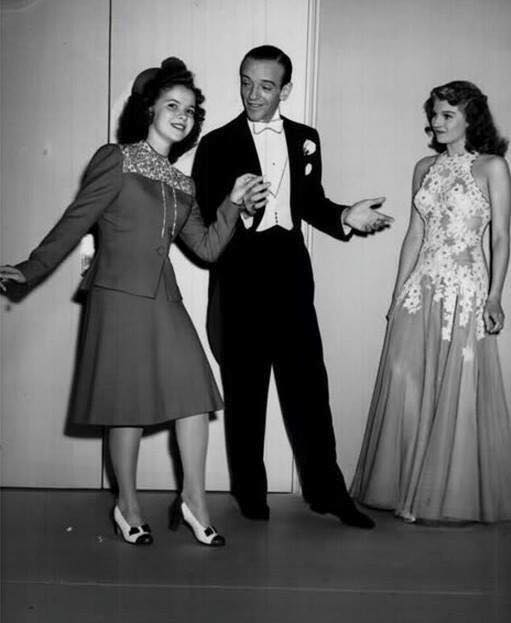 Shirley Temple dances with Fred Astaire as Rita Hayworth