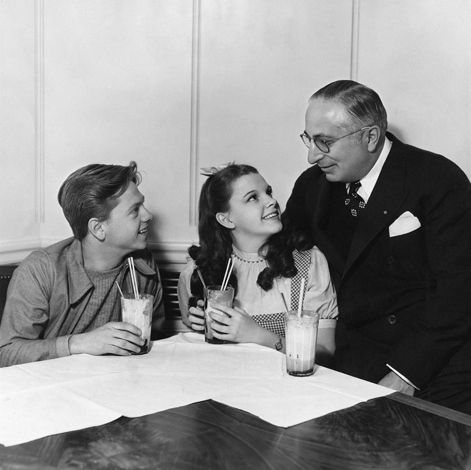 Judy Garland, Mickey Rooney, and MGM Studios patriarch, Louis B. Mayer.