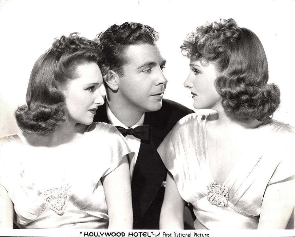 Dick Powell, Rosemary lane, and Lola Lane in Hollywood Hotel.