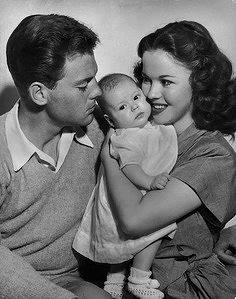 Shirley Temple and John Agar pose with their newborn baby daughter Linda Susan Agar, whom Charles Black later adopted. 1948