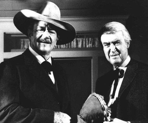 John Wayne and Jimmy Stewart in 'The Shootist.'