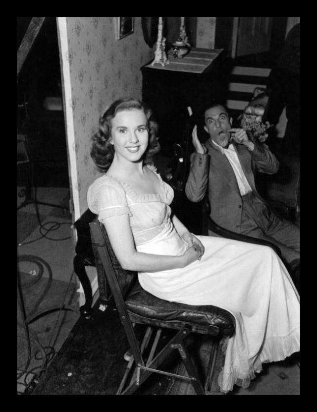 Deanna Durbin and Gene Kelly behind the scenes of Christmas Holiday