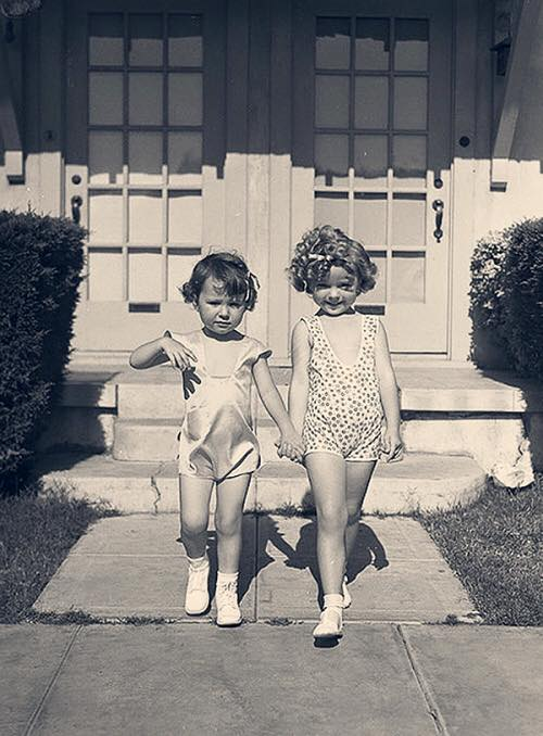Shirley Temple and an educational pictures co-star advertising for the Hollywood Assistance League, 1933.