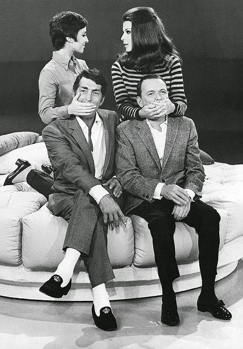 Dean Martin and Frank Sinatra being kept in check by their daughters.