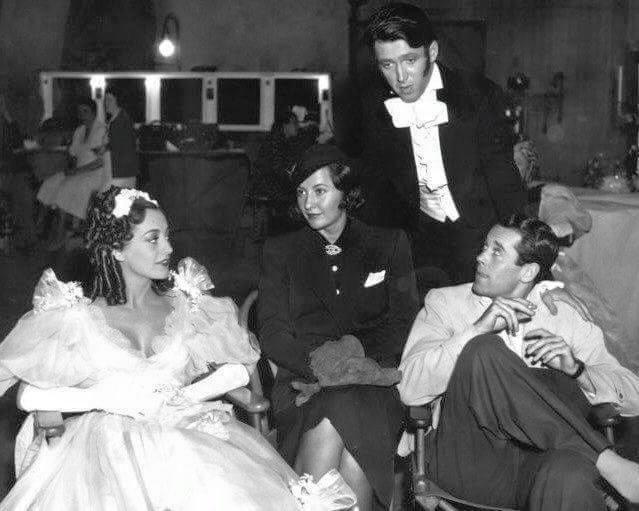 Joan Crawford,Barbara Stanwyck,James Stewart & Henry Fonda on the set of The Gorgeous Hussy -1936.