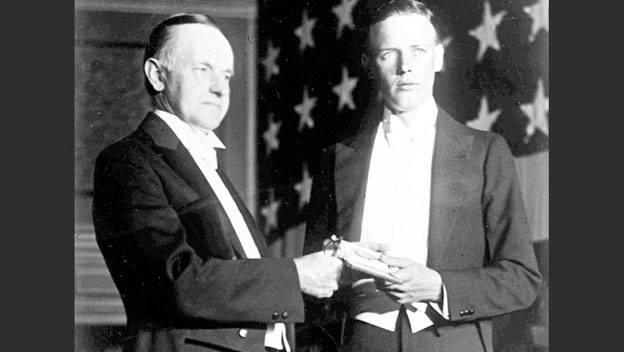 Lindbergh honored by President Coolidge upon his arrival back in the USA