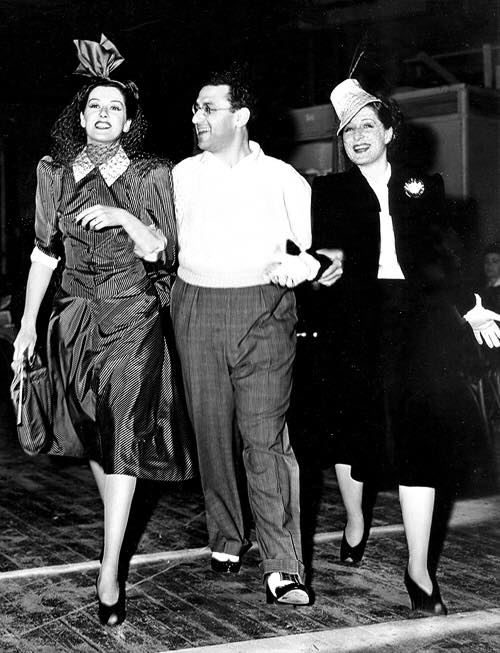 Rosalind Russell, George Cukor, and Norma Shearer on the set of The Women, 1939