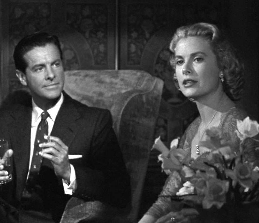 Grace Kelly and Robert Cummings