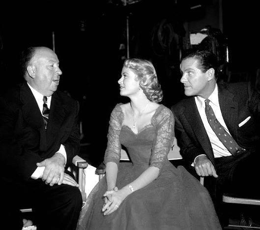 Grace Kelly with Alfred Hitchcock and Robert Cummings on the set of