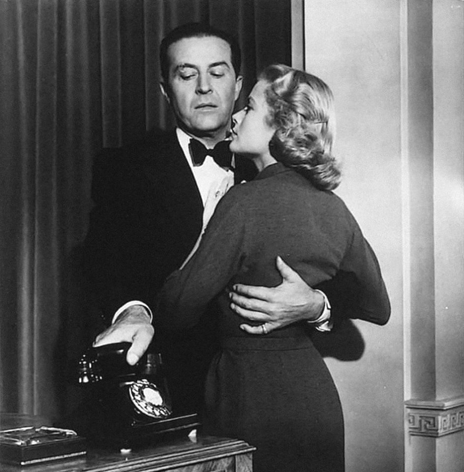 Grace Kelly and Ray Milland in