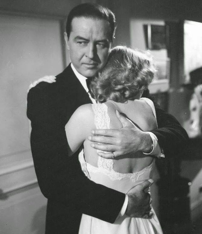 Grace Kelly and Ray Milland in a scene from the movie