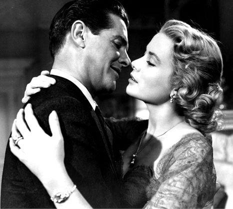 Grace Kelly and Robert Cummings in a scene from the movie