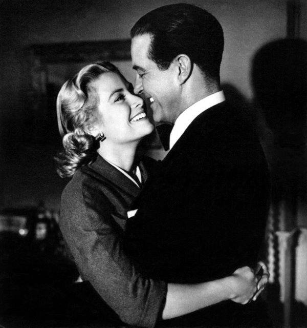 Grace Kelly and Ray Milland during filming of